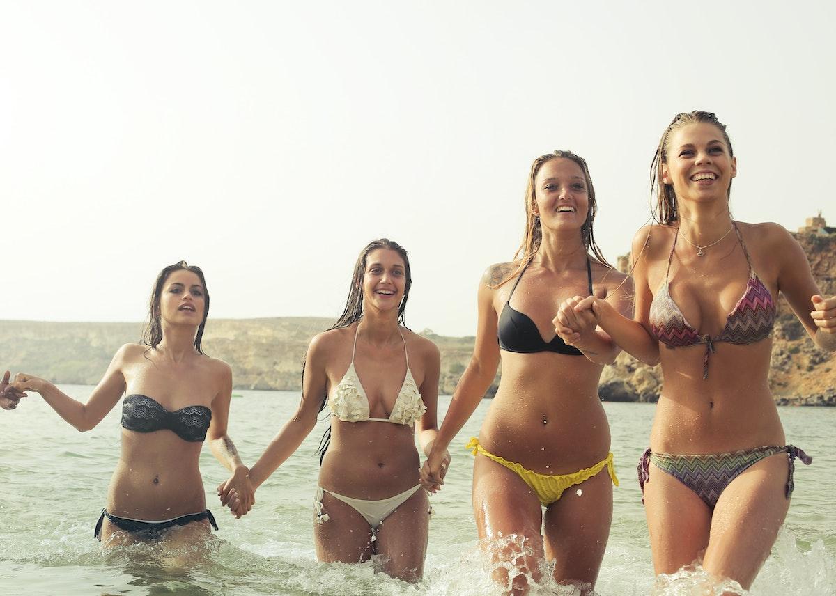 Happy Thanks Day >> Group of Woman Wearing Bikini on Body of Water · Free Stock Photo