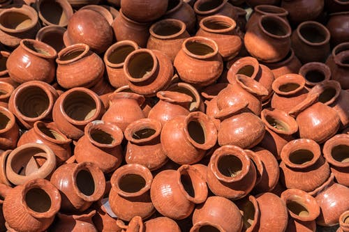 Brown Clay Pot Lot on Black Surface