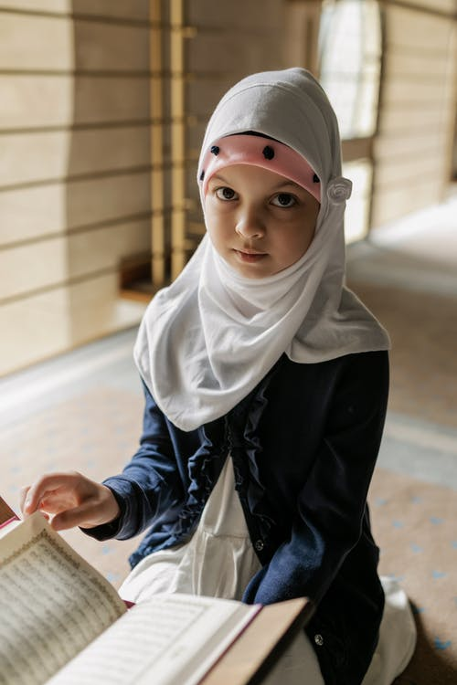 Woman in White Hijab and Blue and White Long Sleeve Shirt