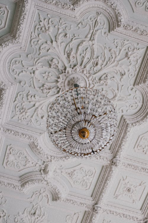 White Intricate Design Ceiling with Light Fixture