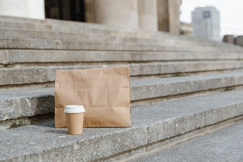 Brown Paper Bag on Gray Concrete Stairs