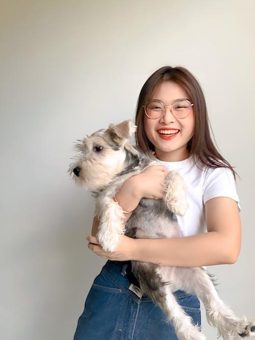 Female Holding a Dog