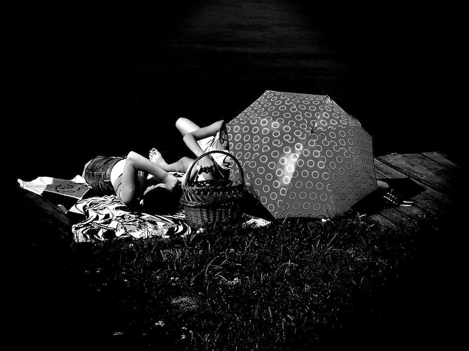 People Laying on Blanket Grayscale Photo