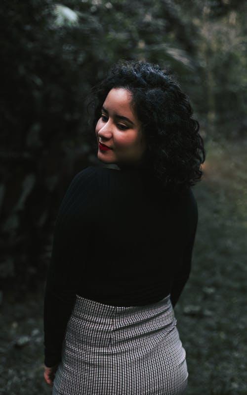 Woman in Black Turtleneck Sweater