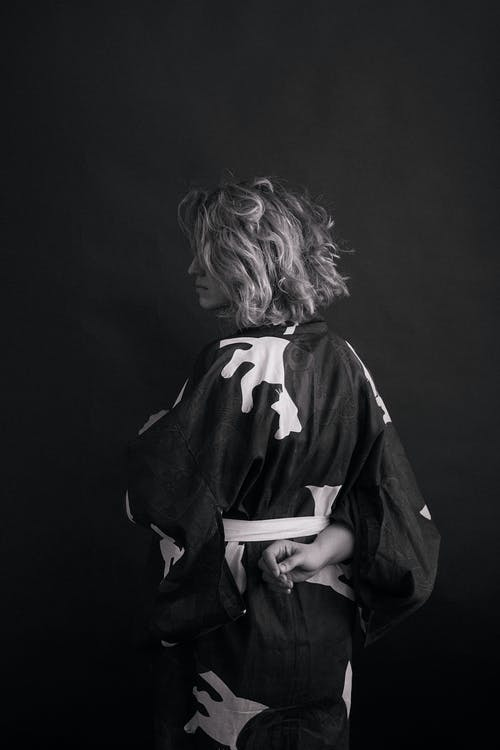 Grayscale Photo of Woman in Black and White Jacket
