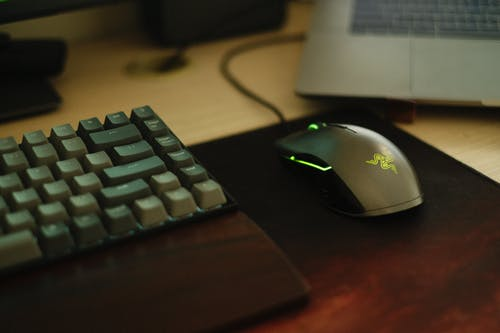 Black and White Corded Computer Mouse Beside Black Computer Keyboard