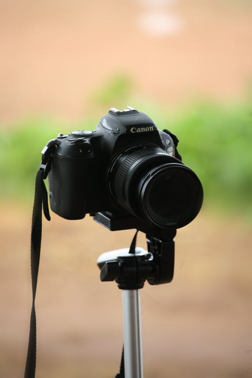 Close-Up Shot of a Black DSLR Camera on a Tripod