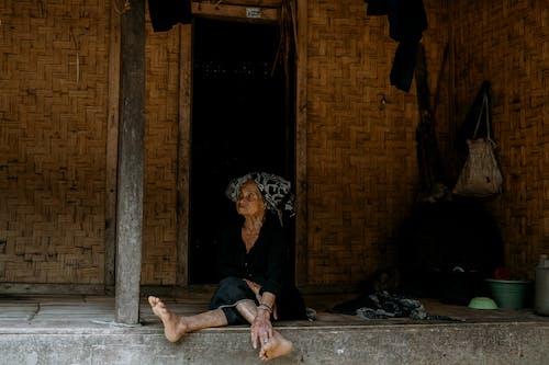 Woman in Black Dress Sitting on Floor