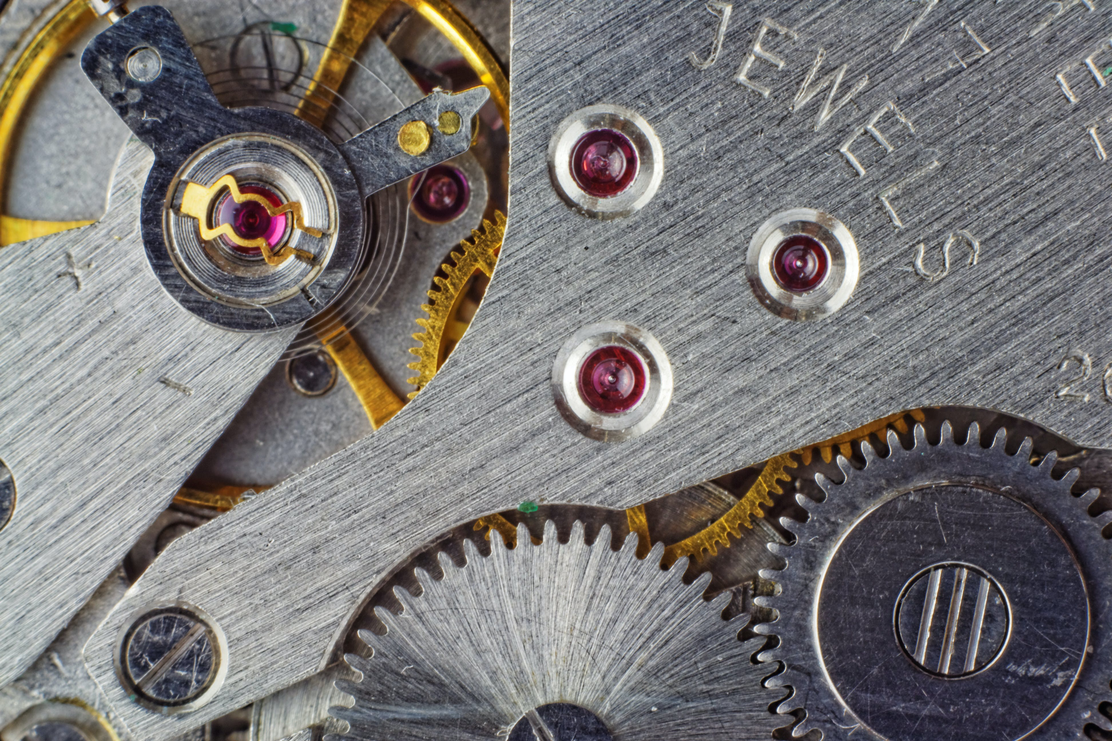 Silver-and-gold-colored Watch Gears