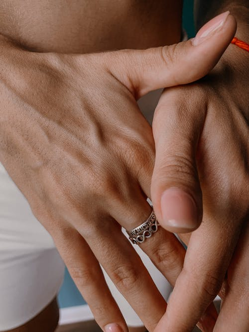 Person Wearing Silver Ring