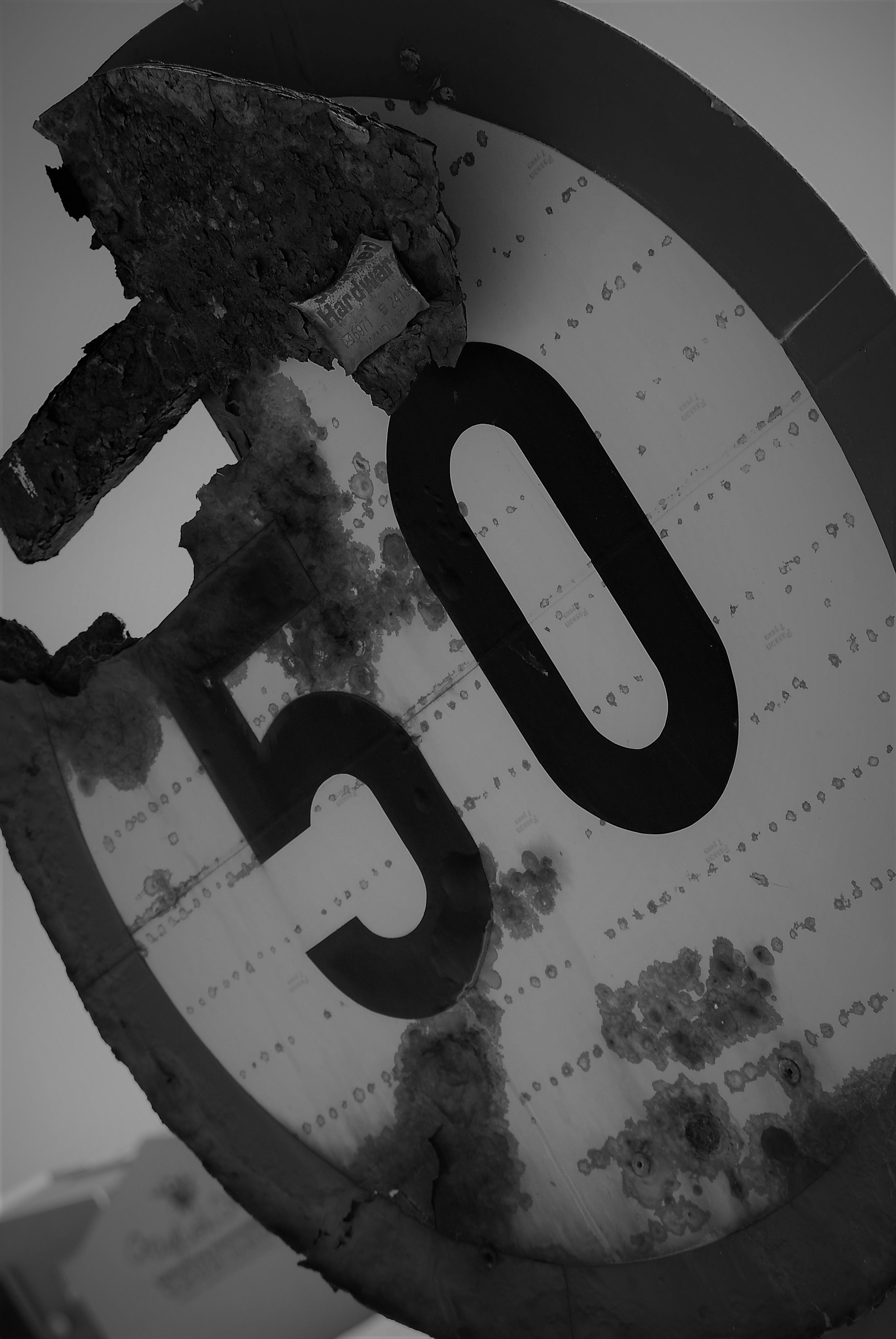 Free stock photo of Black and White Speed Limit 50 Number Old