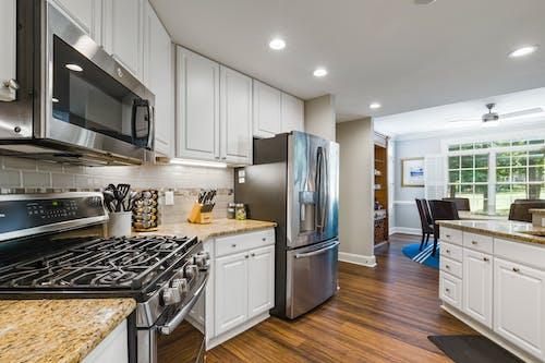 Foto profissional grátis de aço inoxidável, apartamento, armário
