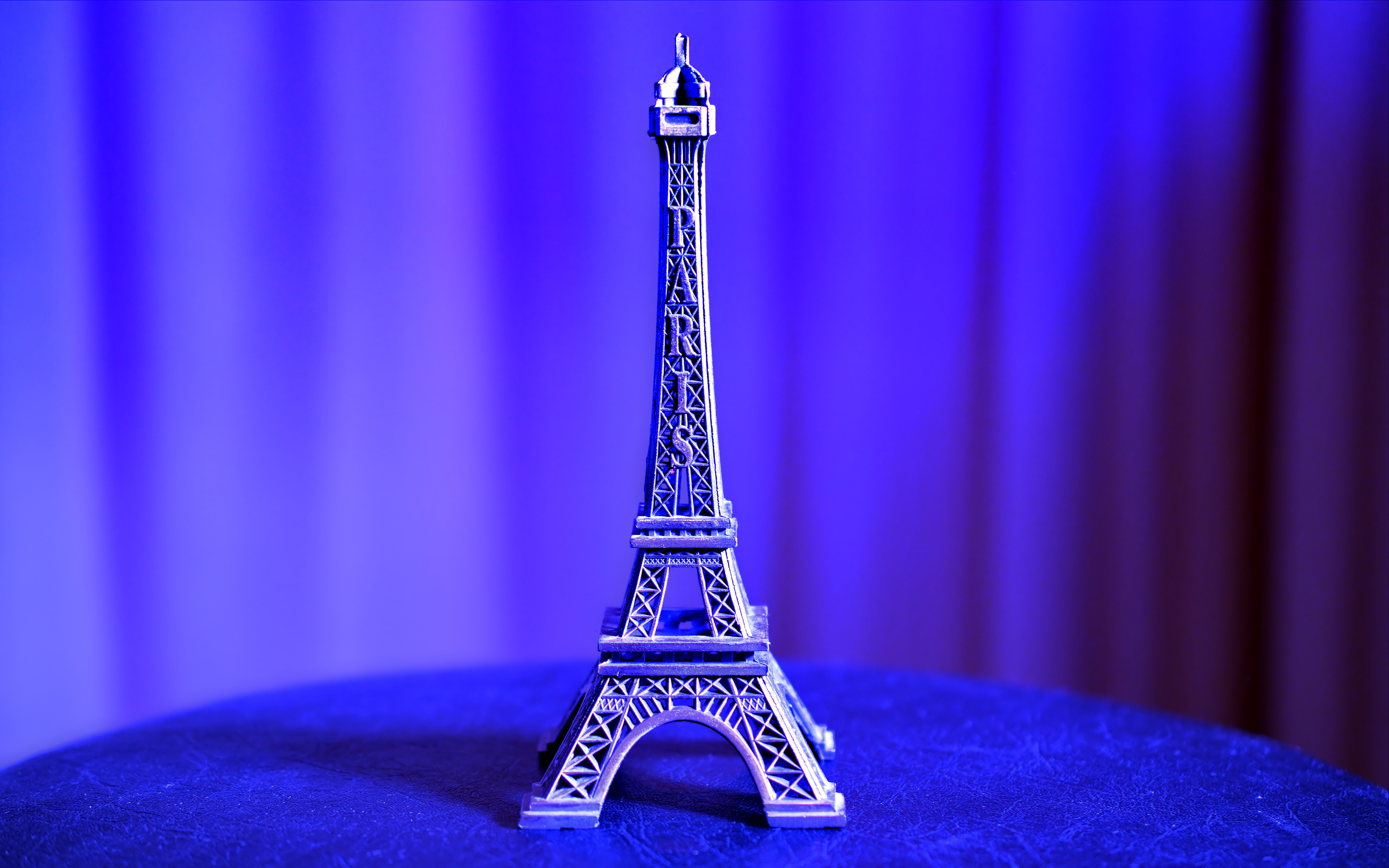 Eiffel Tower Miniature on Blue Textile