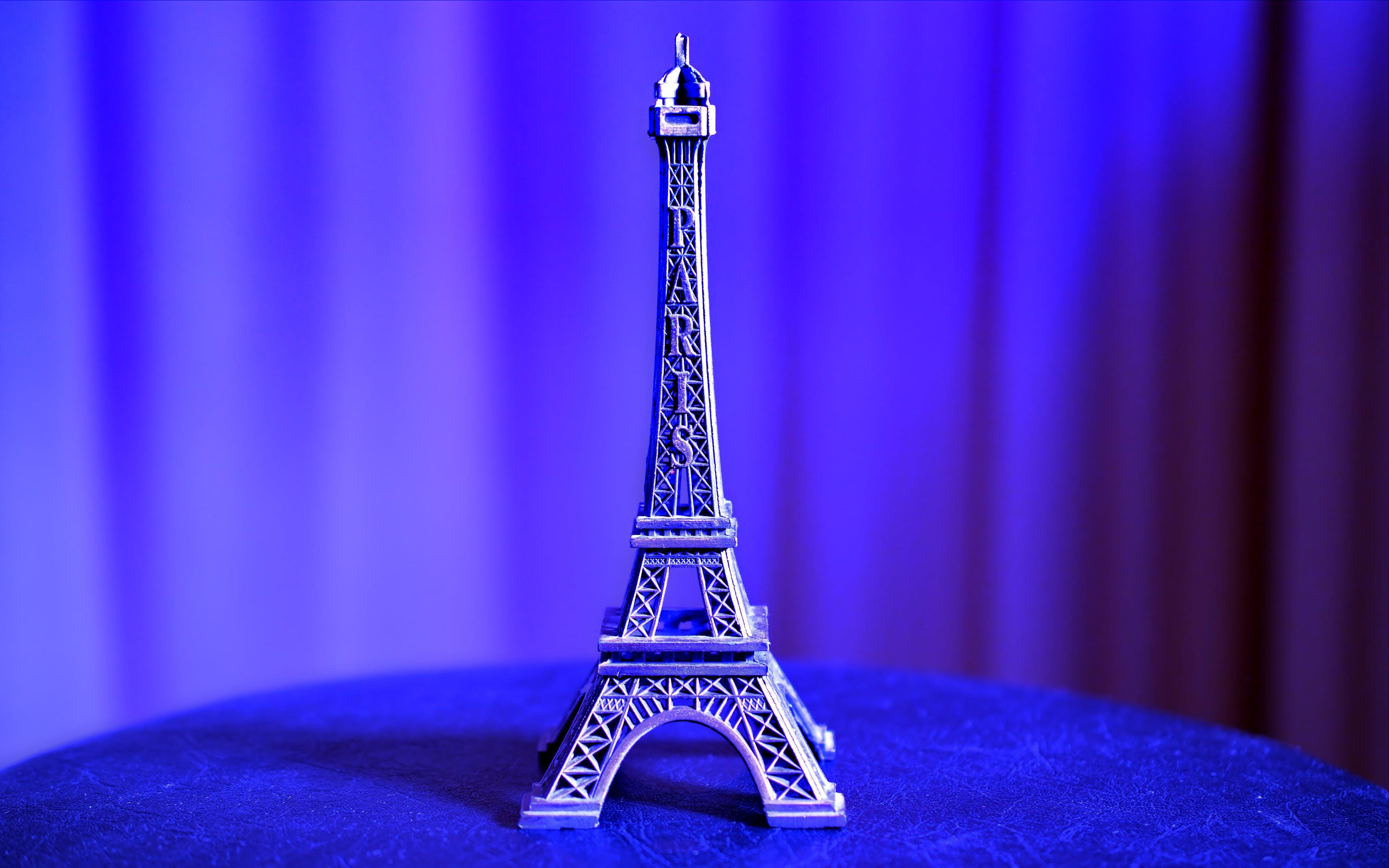 Eiffel Tower Miniature on Blue Textile