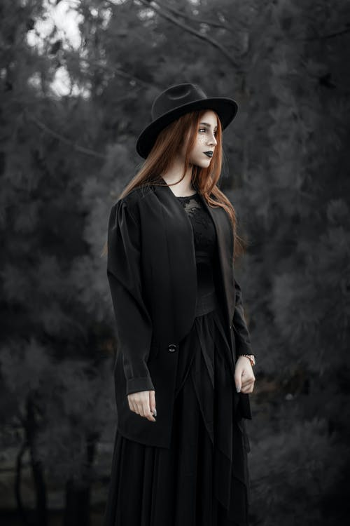 Woman in Black Coat and Black Hat