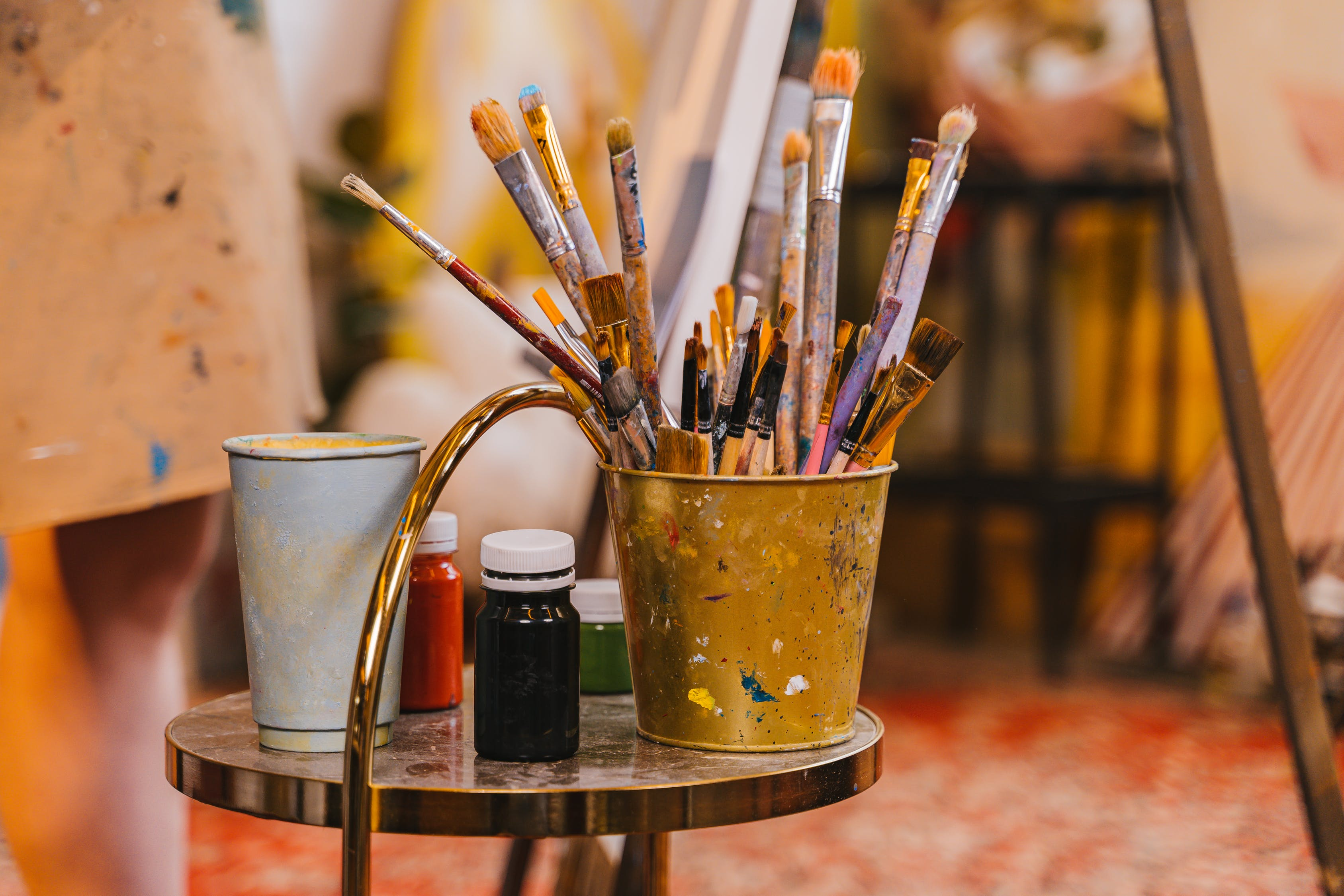 Paint Brushes in Stainless Steel Bucket