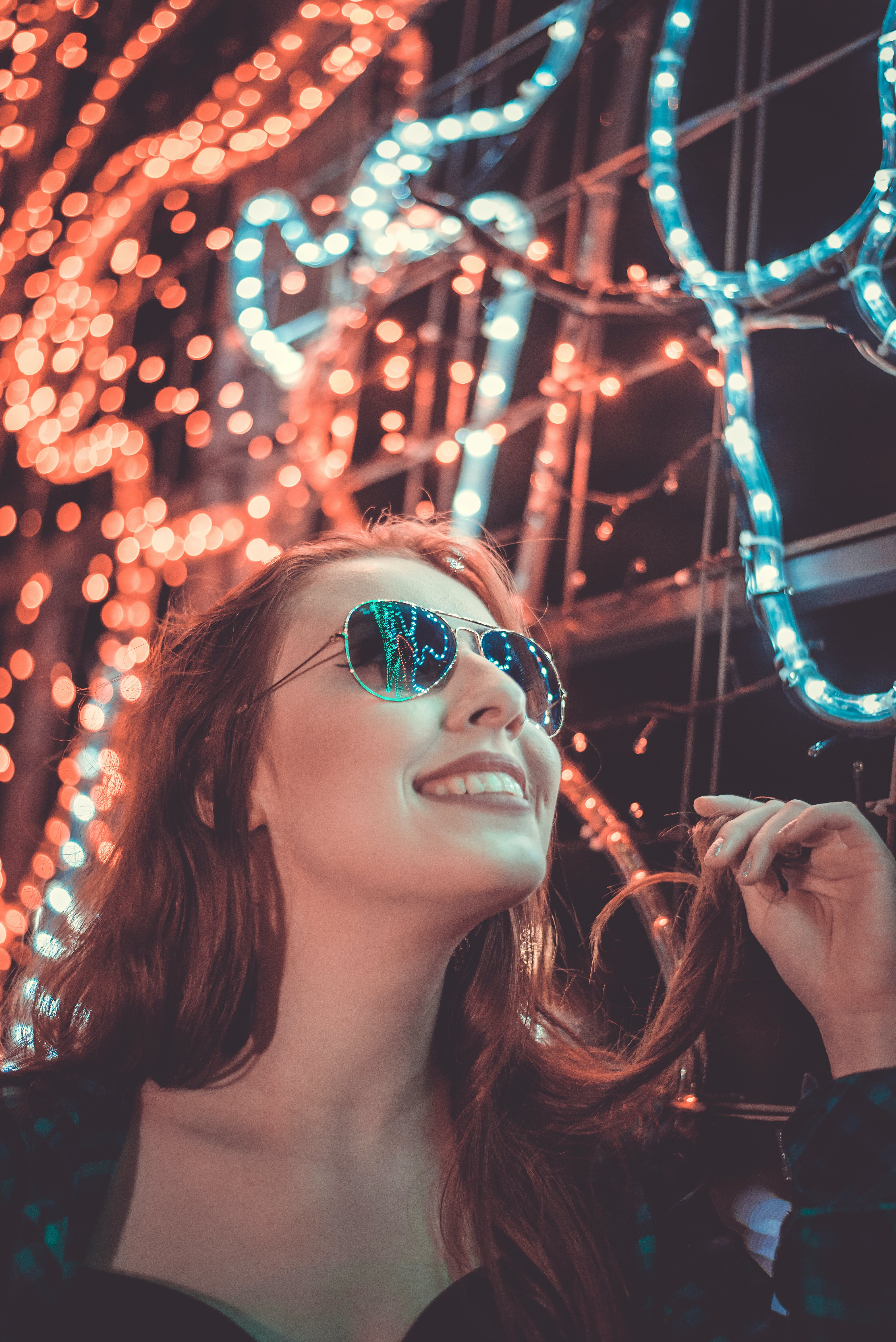 Woman Wearing Sunglasses Holding Her Hair