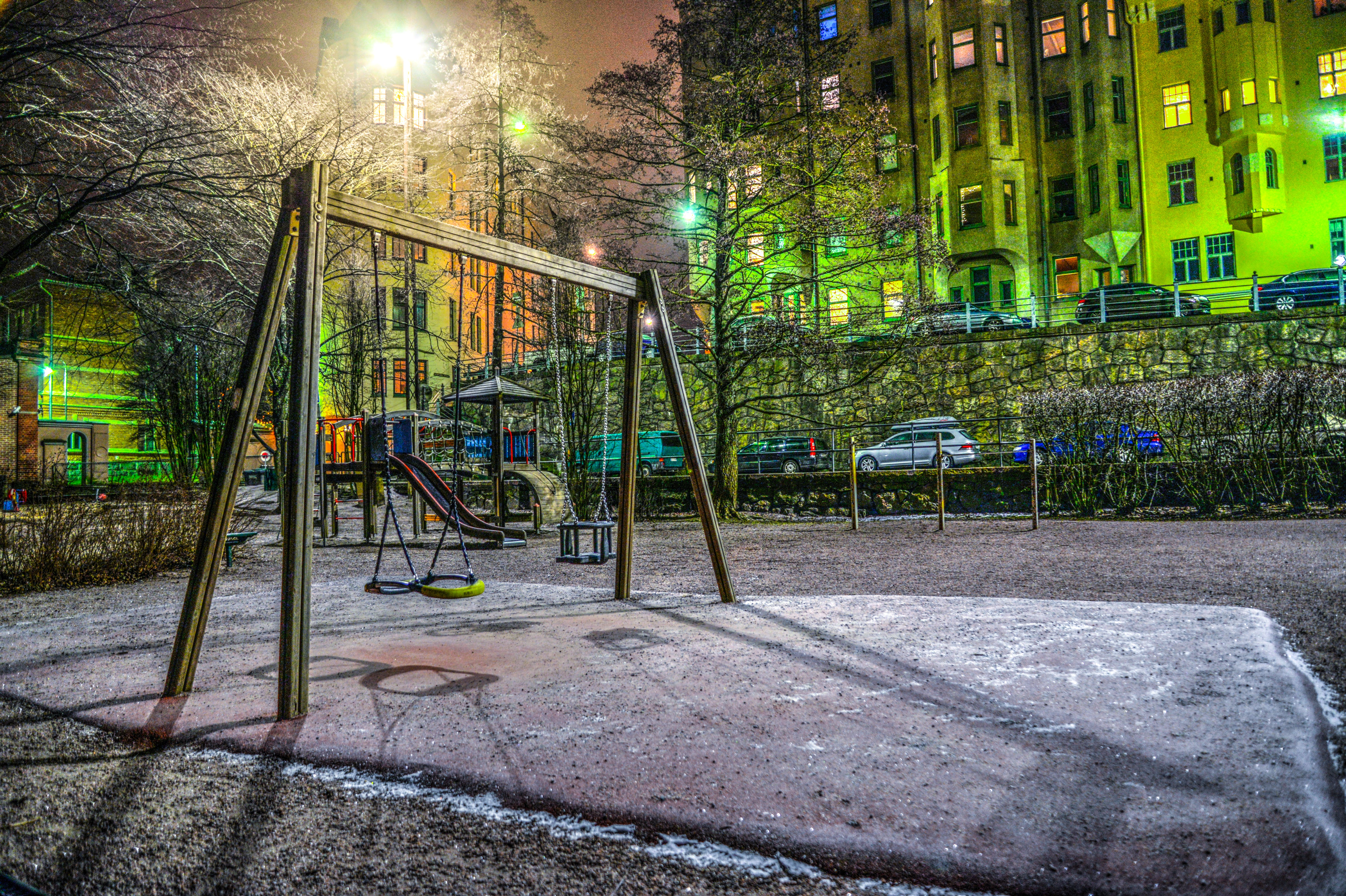 Playground Surrounded With Buildings And Cars