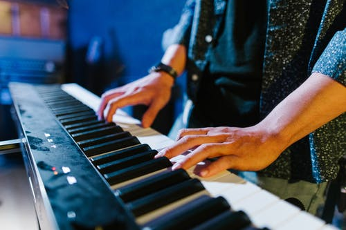 Close-Up Shot of a Person Playing Piano