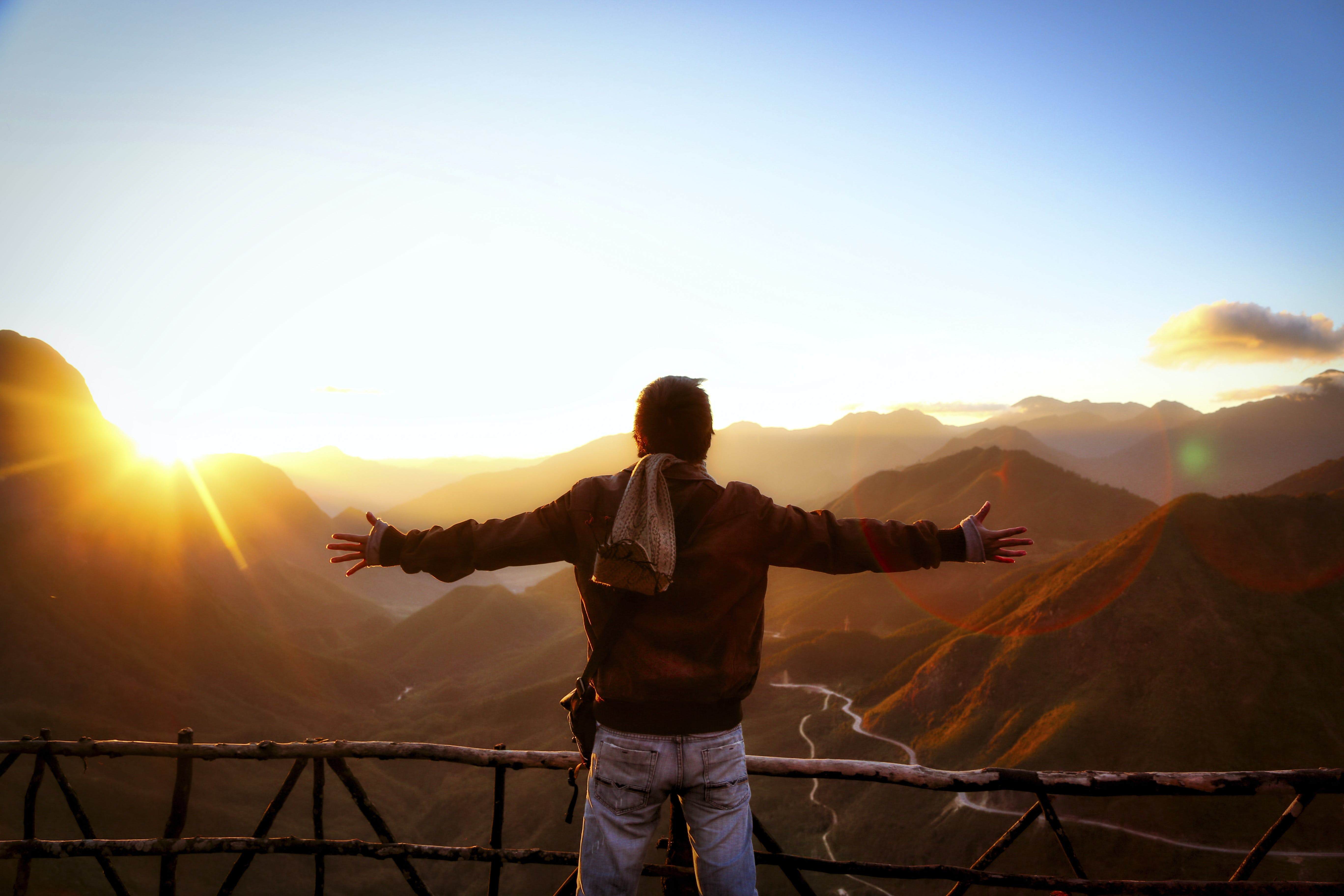 Man in Black Jacket Standing Near Sunset