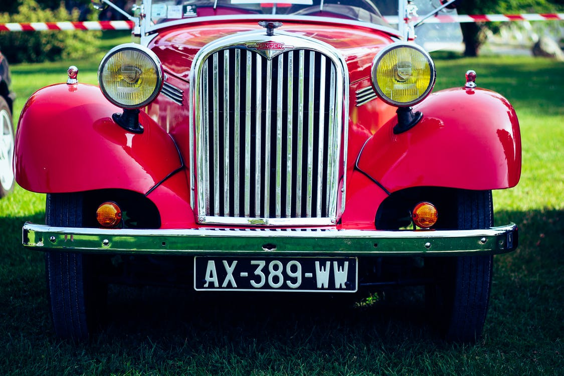 Classic Red Car on Green Grass