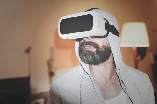 Man Wearing Gray Hoodie and White Virtual-reality Headset
