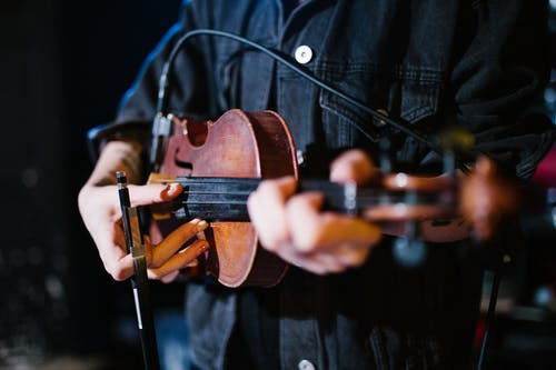 Person in Black Jacket Playing Violin