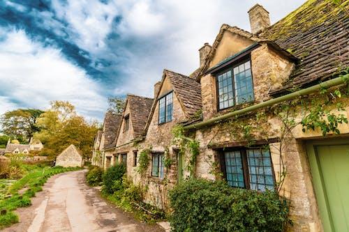 Brown Brick House Under Blue Sky