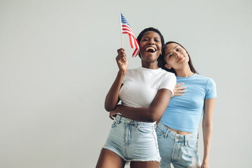Gratis stockfoto met 4th of july, Afro-Amerikaanse vrouw, amerikaanse vlag