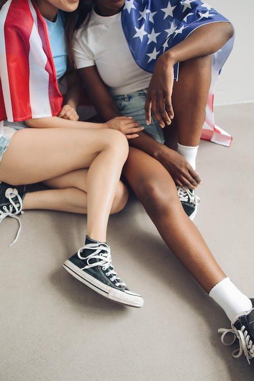 Women Wearing Black Sneakers