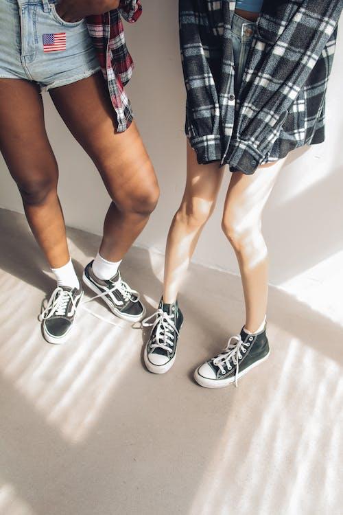 People Wearing Black Sneakers