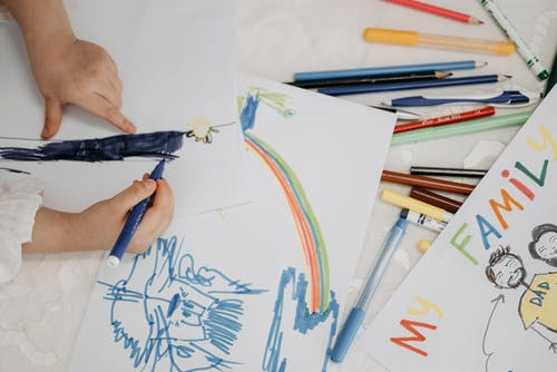 Child Doddles Using Colored Pens