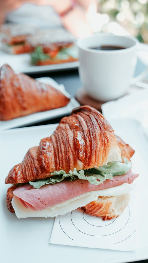 Delicious croissant with ham and cheese