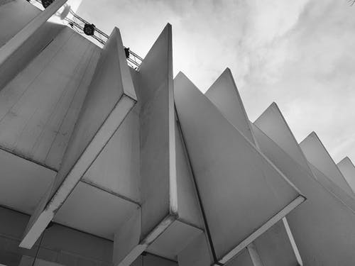 White Concrete Building Under White Clouds