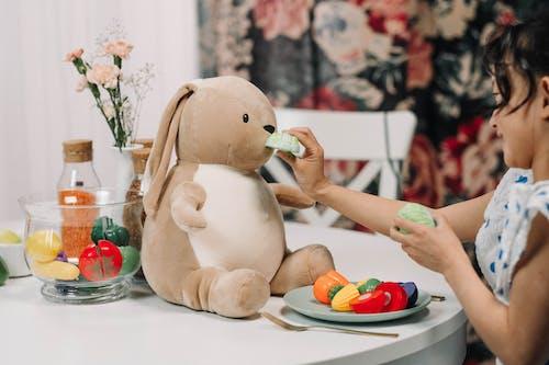 Cute Girl Playing with Her Stuffed Animal
