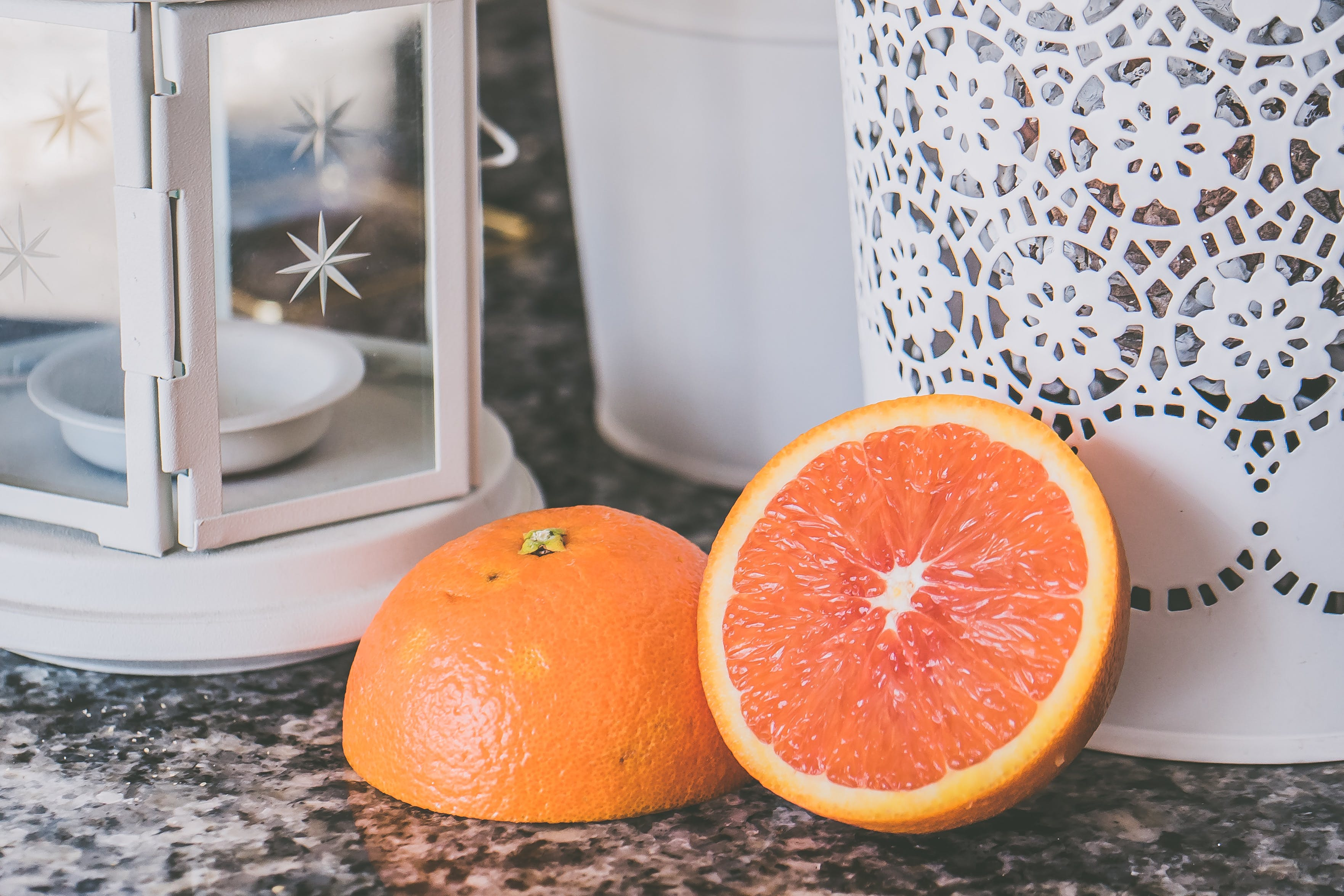 Sliced of Orange Fruit Near on White Framed Glass Candle Lantern