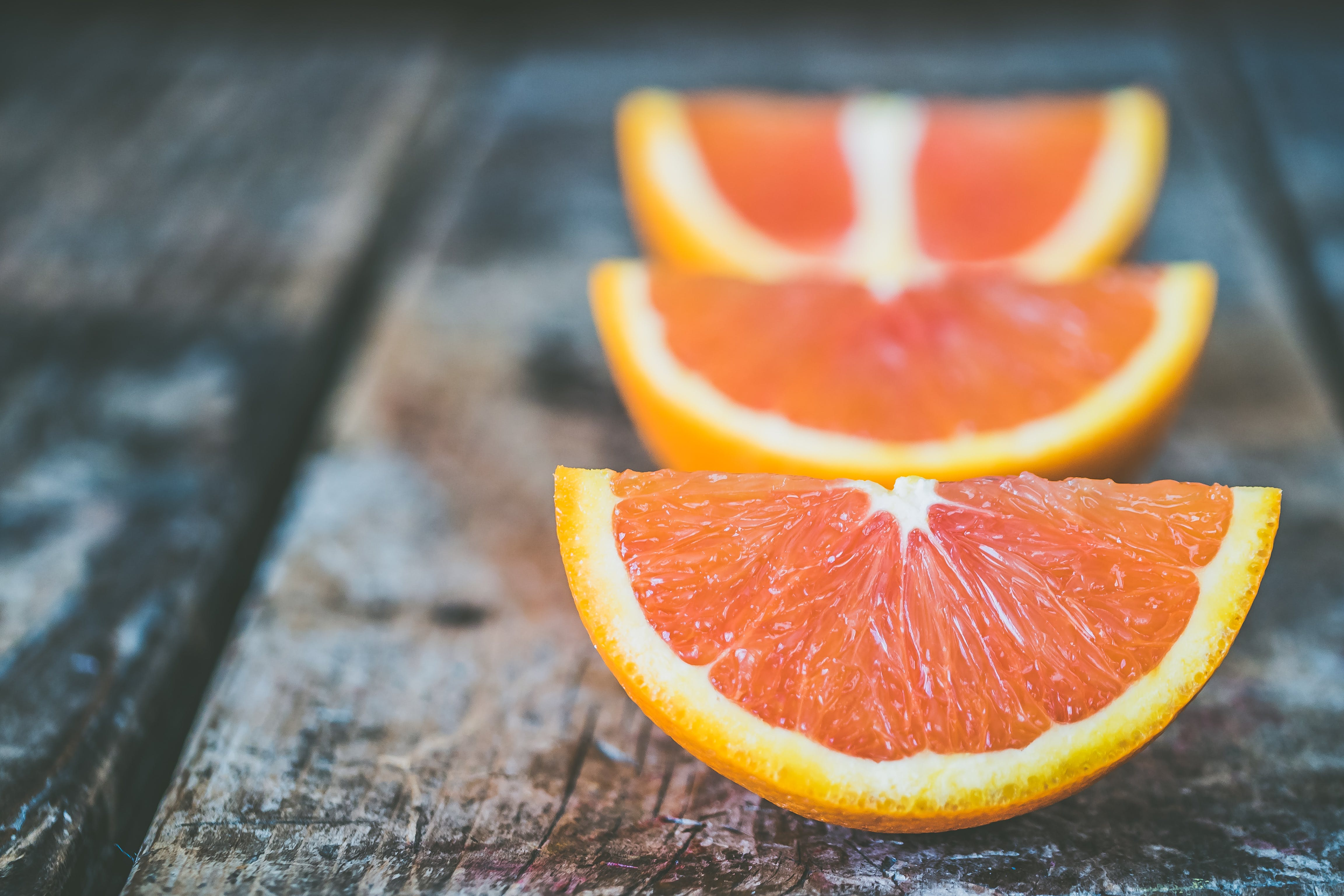 Three Sliced Orange Fruits