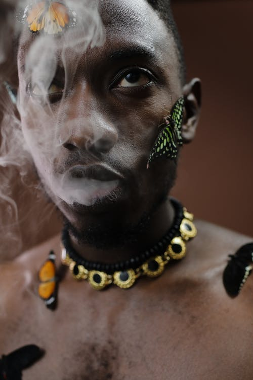 Man Wearing Black and Yellow Beaded Necklace