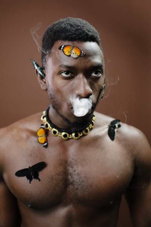 Man With Yellow and Black Beaded Necklace