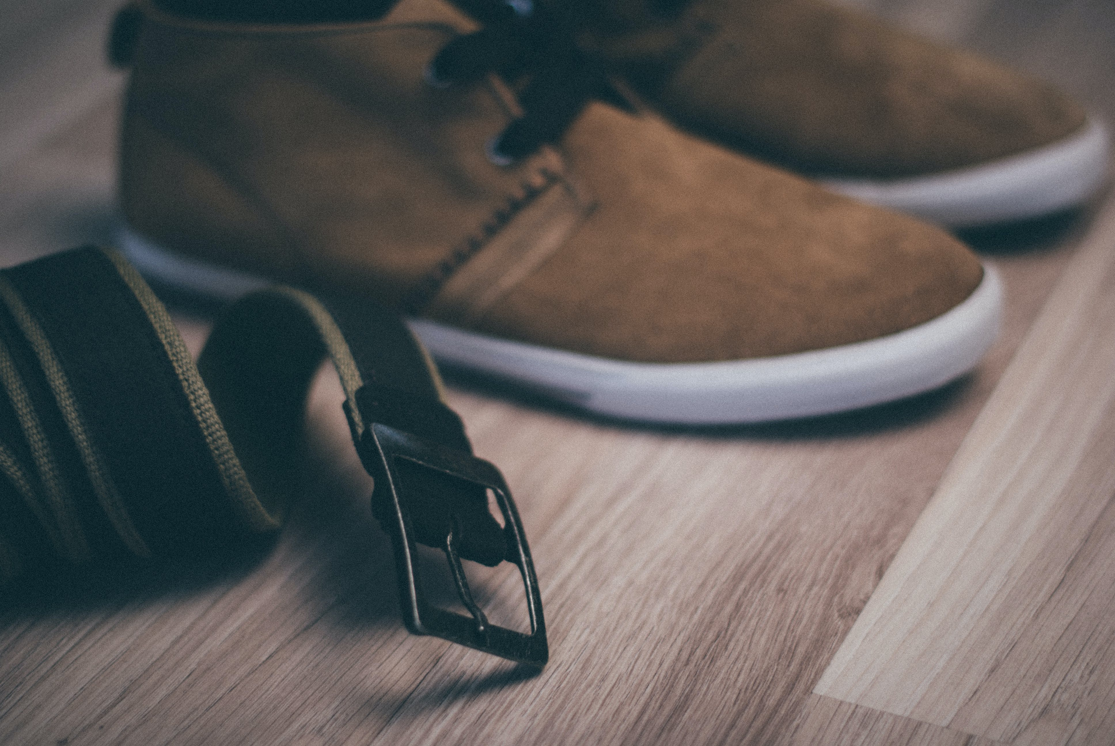 Pair of Brown Leather Sneakers and Black Leather Belt