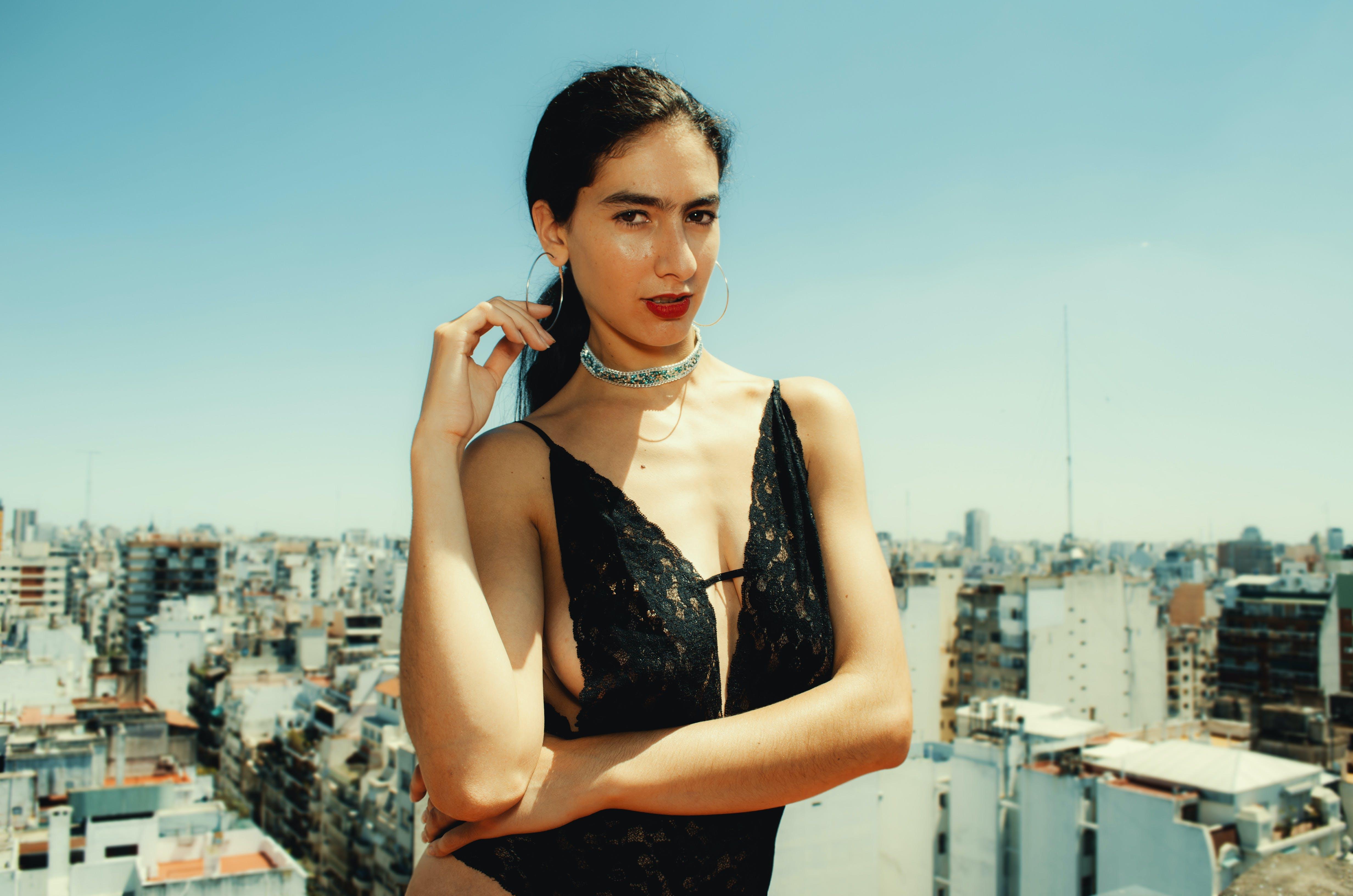 Woman Wearing Black Monokini Behind Highrise Building