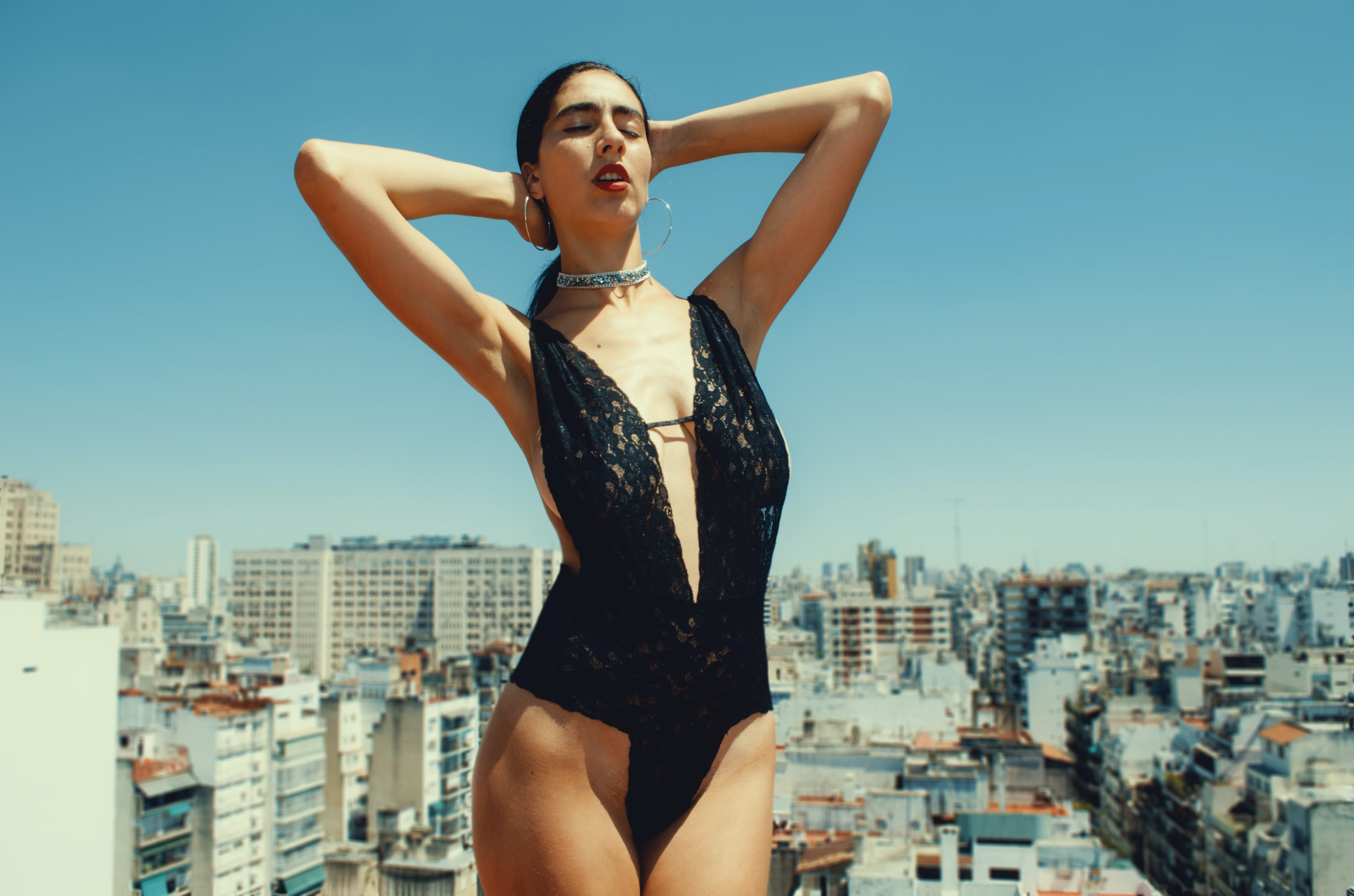 Woman in Black One-piece Swimsuit Under Blue Sky