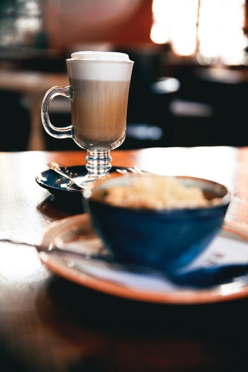 Clear Glass Mug on Blue Ceramic Saucer