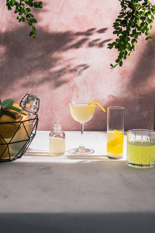 Free stock photo of alcoholic drink, bottle, bowl of fruits