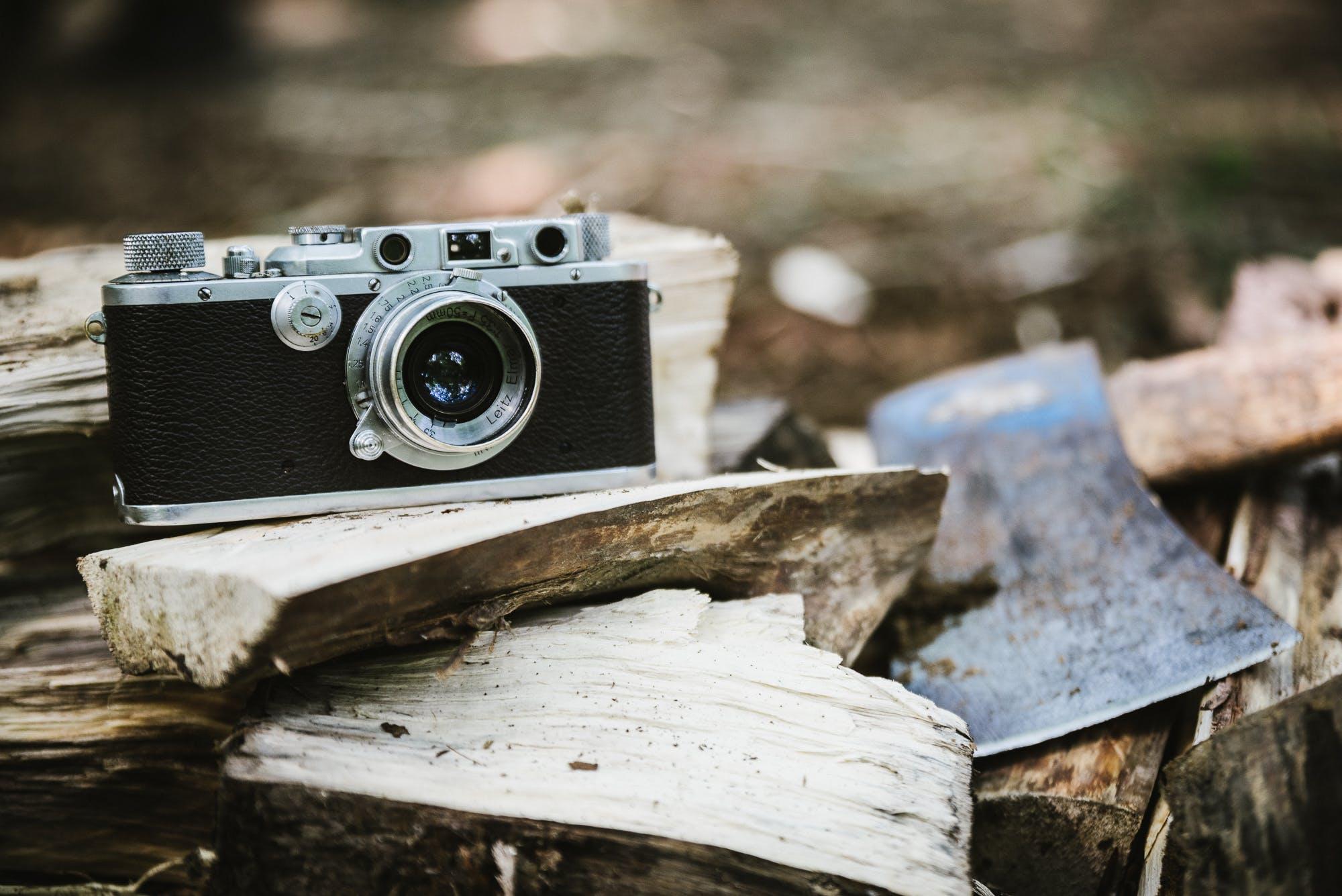 Black Bridge Camera on Wood Burner Beside Pickaxe