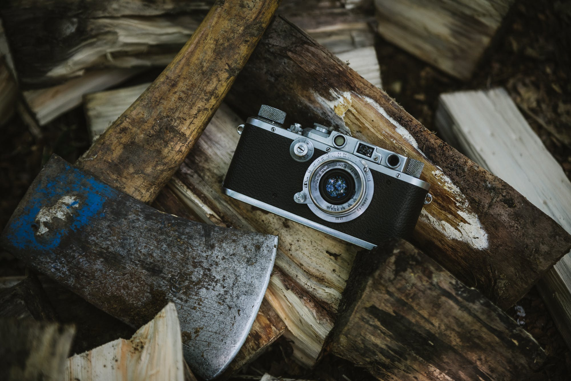 Black And Grey Camera Near Ax