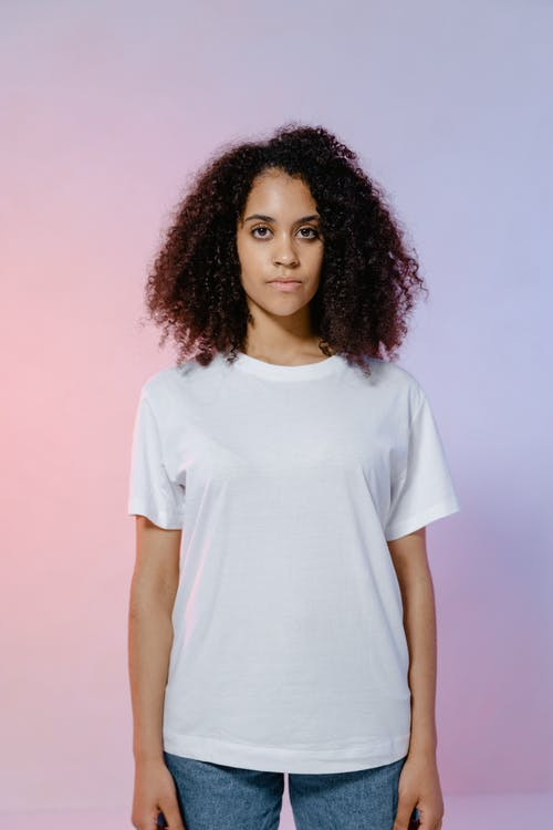 Woman in White Crew Neck T-shirt Standing Straight