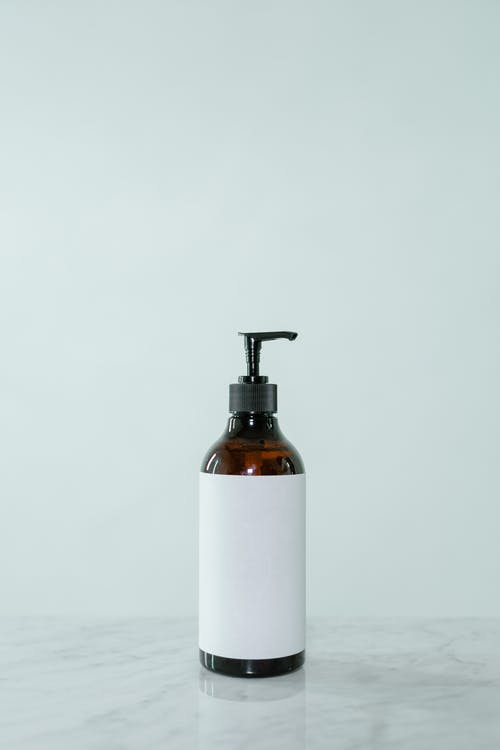 White and Brown Pump Bottle