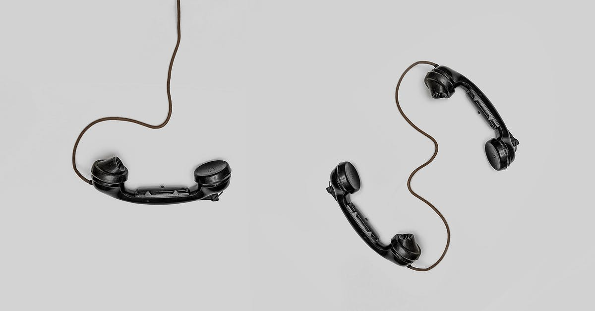 Three Black Handset Toys · Free Stock Photo