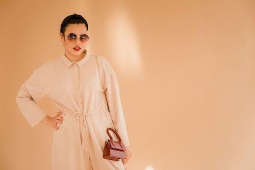 Woman in Pink Long Sleeve Dress